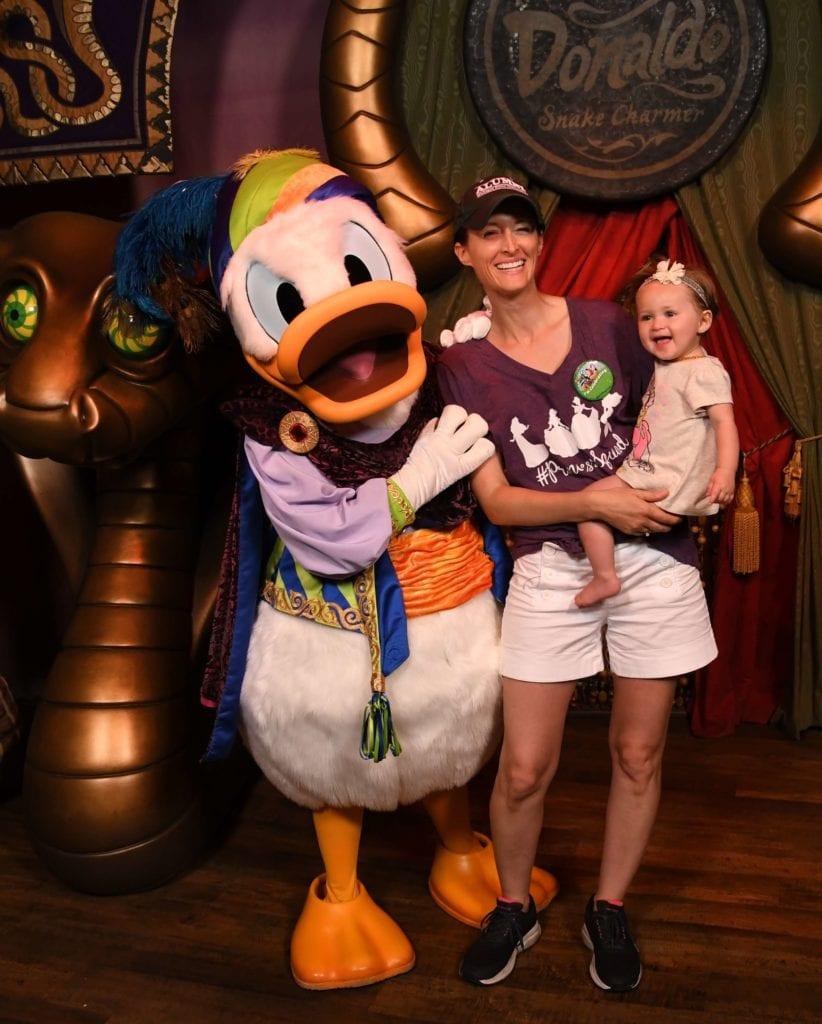 Baby girl meets Donald Duck in Storybook Circus Magic Kingdom Disney World