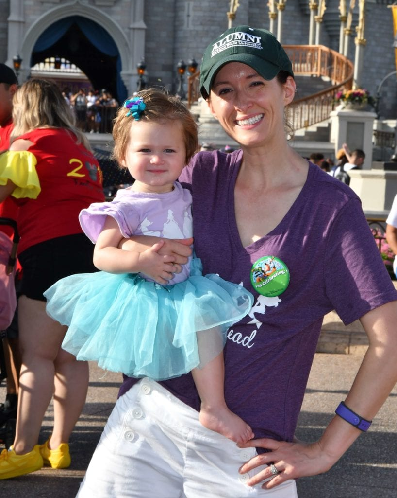 Disney World with a one year old in front of Cinderellas Castle in Magic Kingdom