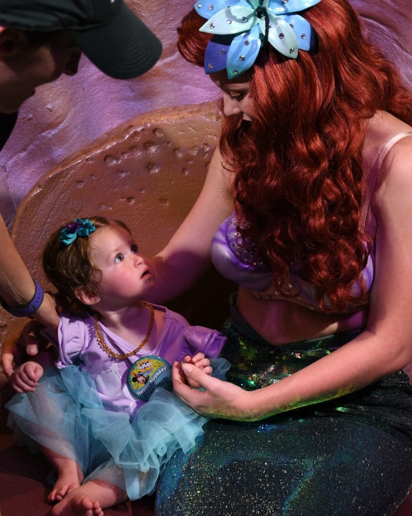 Disney World with a one year old meeting Ariel in Fantasyland Magic Kingdom Florida
