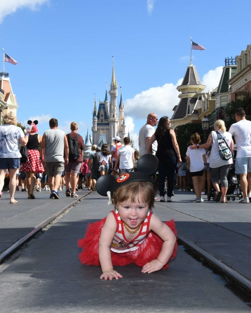 Baby wearing Mickey Mouse ears at Disney World Florida on Mainstreet USA