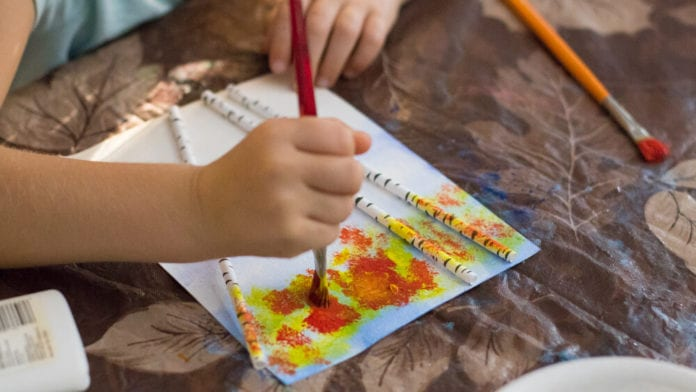 easy fall art projects for elementary school first grader painting leaves on a birch tree